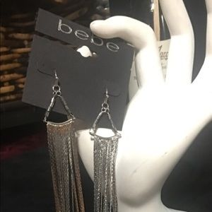 Bebe silver shoulder duster earrings with bling